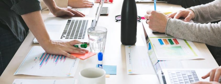 Workers at shared desk space