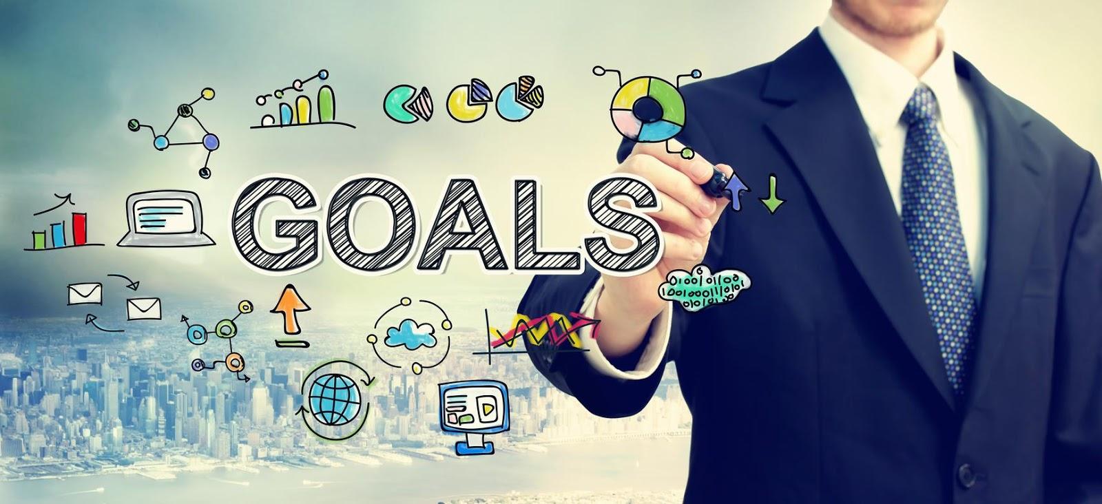 Business man drawing goals