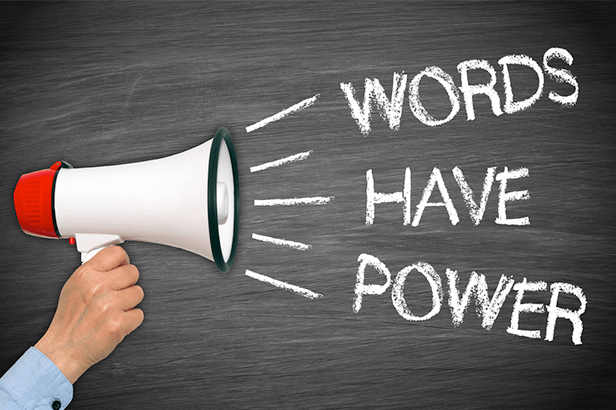 """megaphone behind held by a hand with words coming out of it """"words have power"""""""